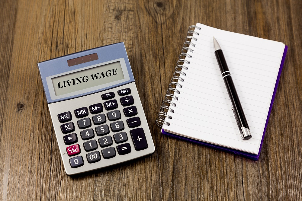 Living Wage Concept with calculator, notepad and pen