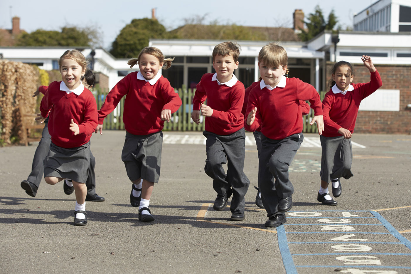 children running in the school playground