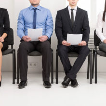 Group of mixed gender people seated waiting for an interview