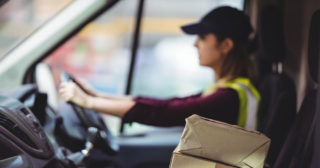 Female Delivery Driver driving a van